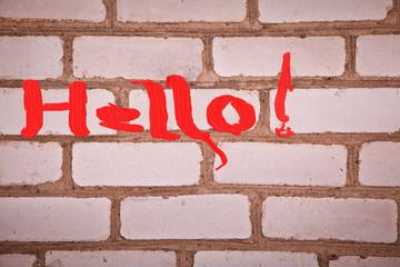 Надпись Hello на кирпичной стене