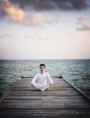 Meditation Man sitting on a jetty (Maldives)