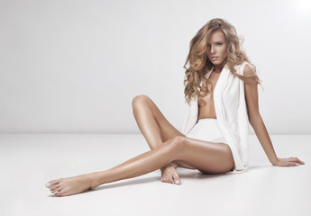 Obraz Young sexy woman on grey background - fototapety do salonu