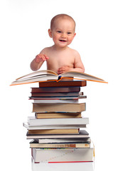 Portrait of a little boy with a stack of books