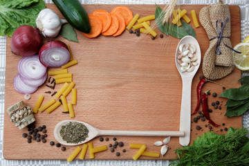 Frame made of spices and vegetables on a wooden table.