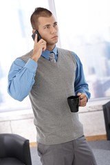 Businessman with phone and coffee