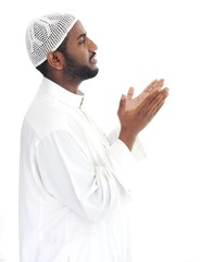 Black arabic man praying