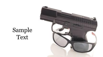 Hand Gun and Glasses