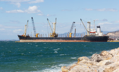 A bulk carrier ship loading cargo at port