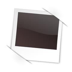 Polaroid in Laschen gesteckt