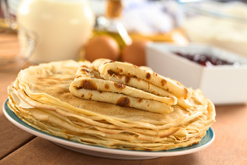 Fresh homemade crepes on plate with ingredients