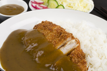 Katsu Kare served with salad, steamed rice and curry sauce.
