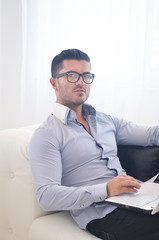 happy young man relax at home with laptop