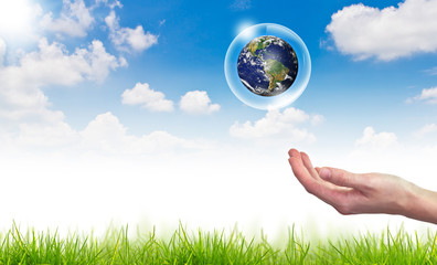 Eco concept : Hand hold globe in bubbles against the sun and the