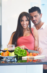 Happy young couple having fun in the modern kitchen