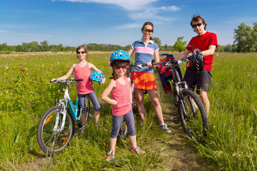 Wall Murals Cycling Happy family on bikes, cycling outdoors. Family sport