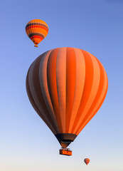 Balloons in the sky at sunrise