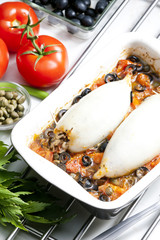 baked sepia with tomatoes and black olives filled with pearl bar
