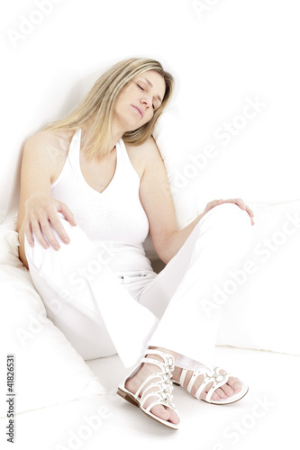 aaef6ff21 relaxing and sitting woman wearing white clothes and sandals