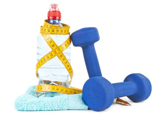 Two dumbells, water in bottle and towel