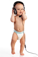 Portrait of a cute one-year old boy wearing a headset