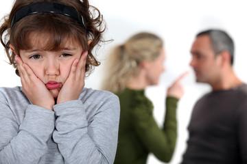 Little girl upset by parents arguing