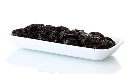 yummy dried plums in packaging isolated on white