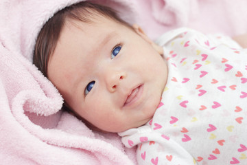 Two months old cute baby with blue eyes