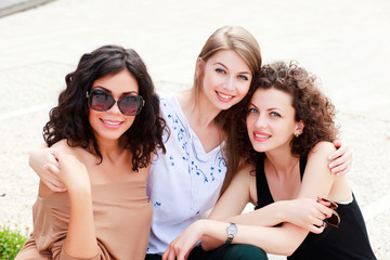 three beautiful women smiling