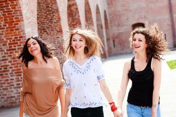 three beautiful women laughing and having fun