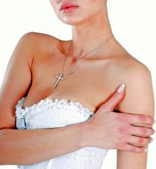 Close-up of female model posing in white lingerie