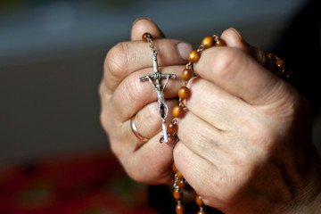 prayer old woman hands and rosary