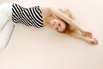 A beautiful young woman lying on the floor
