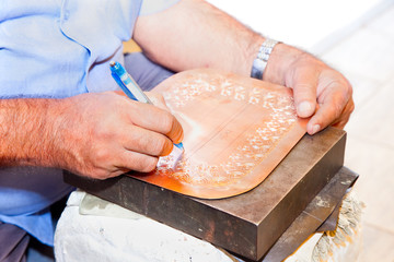 Making traditional engraved cupper in Acre, Israel