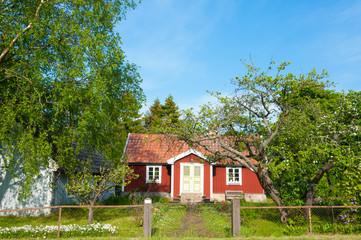 Typisch rotes Holzhaus auf der Insel Öland, Schweden
