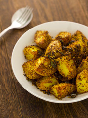 close up of a bowl of crusty baked potatoes