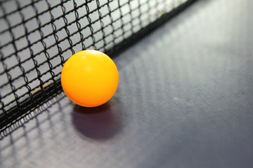 Orange table tennis ball