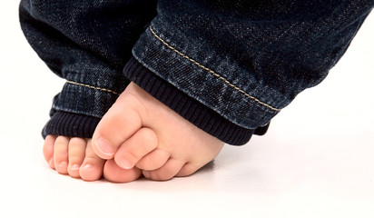 Baby feet and denim