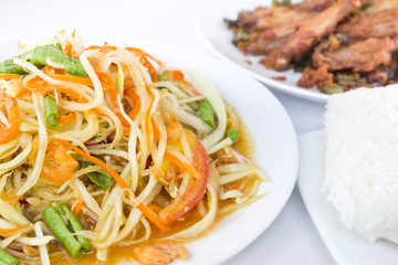 Spicy green papaya salad with fried chicken and rice,  Thai cuis