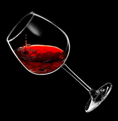 drops of red wine dripping into a glass