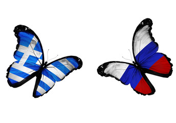 Concept - two butterflies with Greek and Russian flags flying