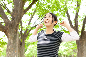 young asian woman relaxing in the forest