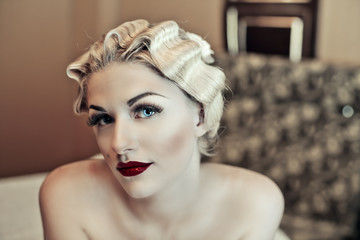 beautiful young sexy woman with vintage make-up and hairstyle.