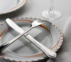 Crossed fork and knife on the plate