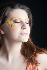 Close up portrait of beautiful girl with leopard make up.