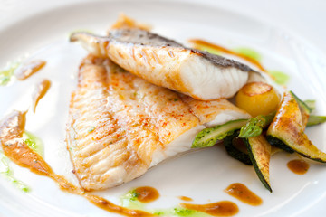 Grilled turbot fish with vegetables.
