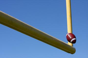 Football kicked through the Goal Posts