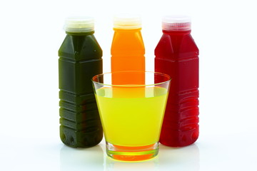 Many kinds of fruit juice in the bottle and glass.