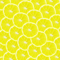 Yellow background with citrus fruit of lemon slices