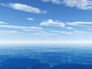 cloudy sky leaving horizon above blue surface of sea