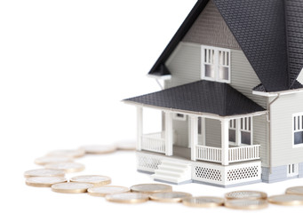 Coins around the house architectural model, isolated