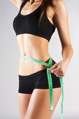 Woman measuring perfect body, healthy lifestyles concept