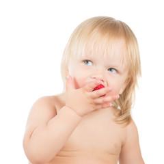 Adorable toddler girl eat strawberry sitting on white background
