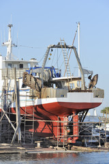 Commercial fishing boat in dry dock for repair